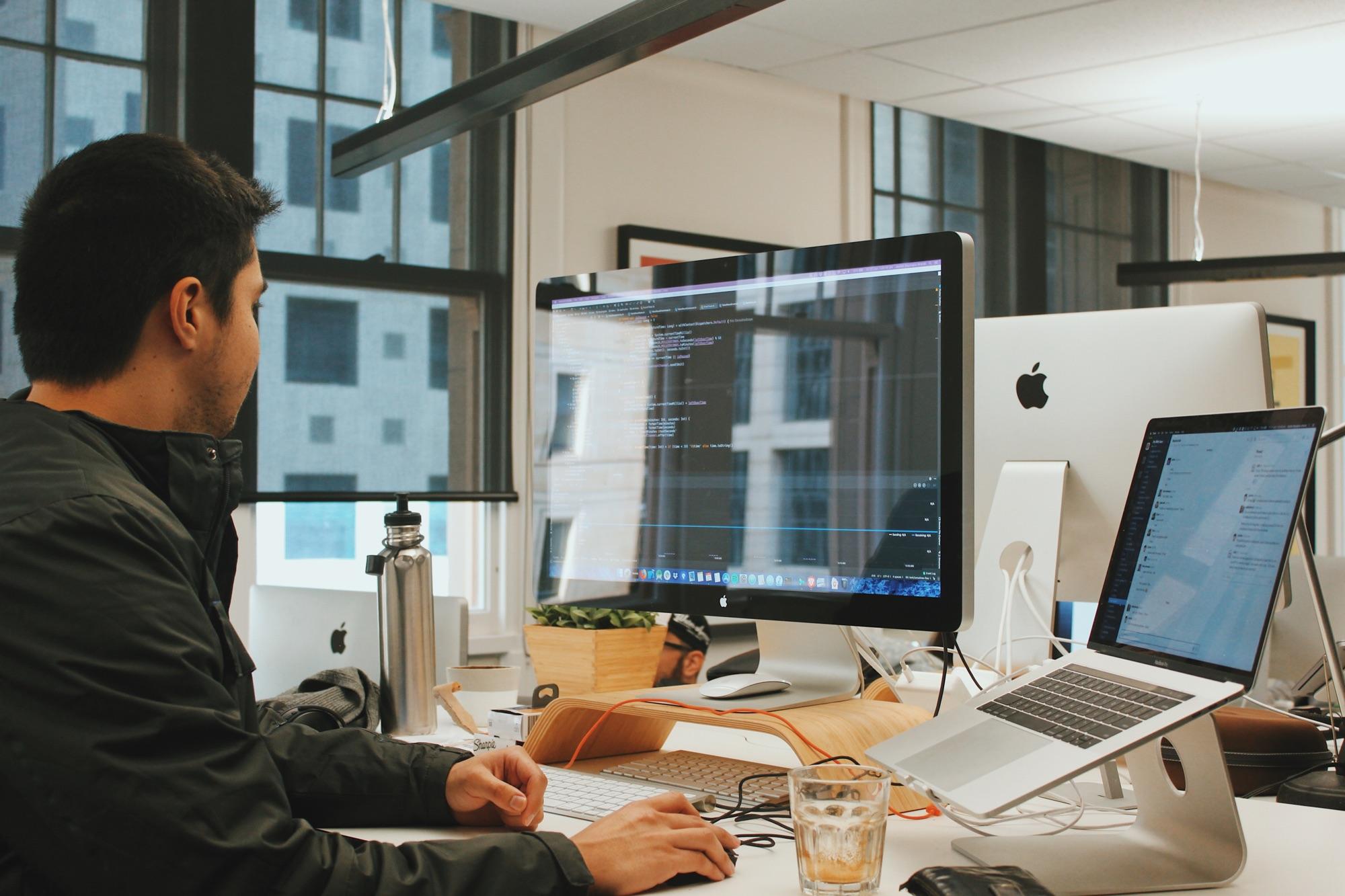 Jayden at his desk